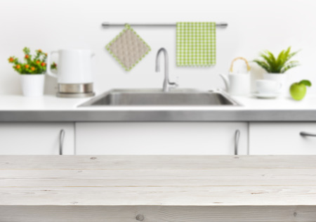 Wooden table on kitchen sink interior background