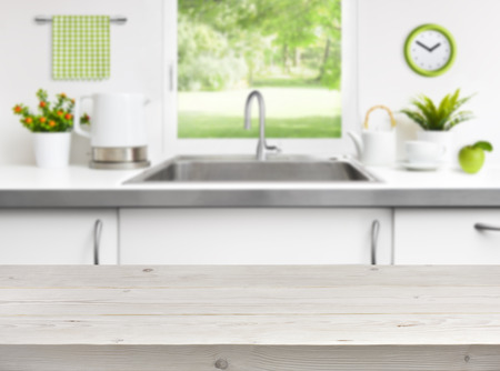 kitchen: Wooden table on kitchen sink window background