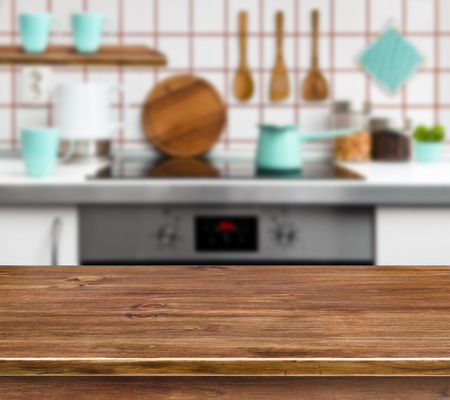 red kitchen: Wooden texture table on defocused modern kitchen background