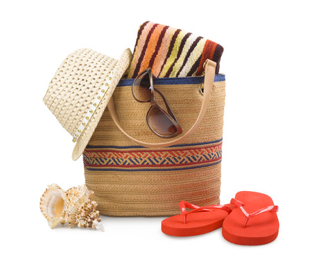 bag: Beach bag and towel with sunbathing accessories isolated on white Stock Photo