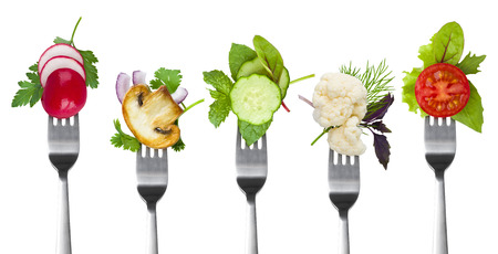 Collection of forks with herbs and vegetables isolated on white