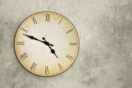 Vintage wall clock over grey grunge background