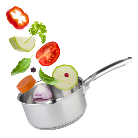 stew pot: Stew pot with tossed up vegetables isolated on white Stock Photo