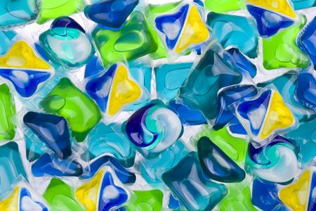 lavar platos: Antecedentes de diversas cápsulas con detergente y jabón lavavajillas Foto de archivo
