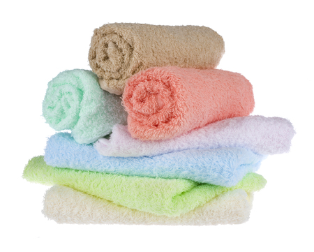 terrycloth: Terrycloth towels arranged in a stack on white background Stock Photo