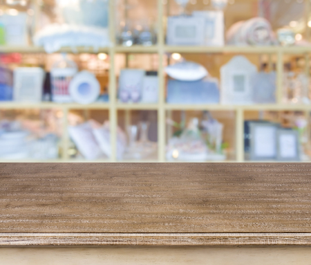 souvenir: Empty wooden table and blurred abstract store background