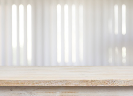 jalousie: Wooden table on defocuced window with jalousie background