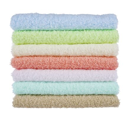 terrycloth: Stack of fluffy towels isolated on white background