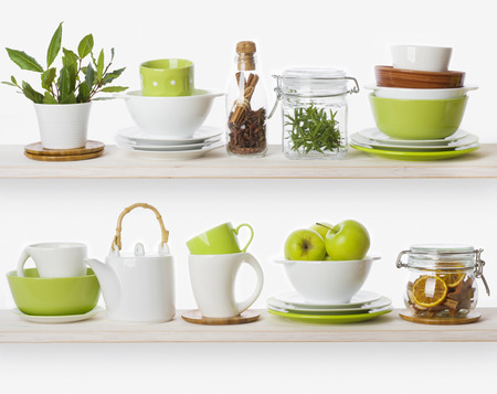 green apple: Shelves with various food ingredients and kitchen utensils Stock Photo