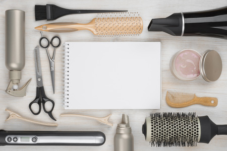 electric tools: Hairdressing tools on wooden background with blank sheet in centre