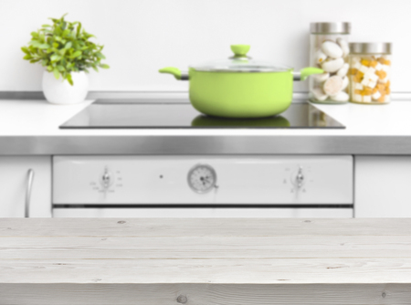 kitchen bench: Wooden planks table top over kitchen bench and oven background