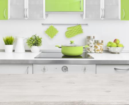 kitchen bench: Wooden table on green modern kitchen bench interior background