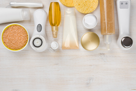 Beauty treatment products on wooden background with copyspace at bottom Standard-Bild