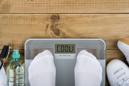 white socks: Weight loss concept with top view of weighting on scales