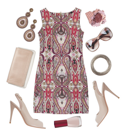 multicoloured: Multicoloured patterned dress, shoes, cosmetic and accessories isolated on white Stock Photo