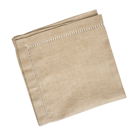 Brown linen napkin isolated on white background Foto de archivo