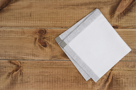 white towel: Above view of folded linen napking on wooden texture background