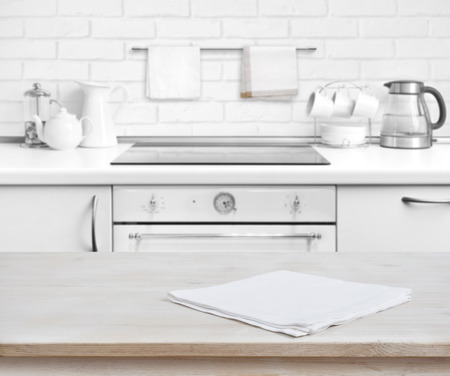 kitchen bench: Wooden table with towel over defocused rustic kitchen bench background