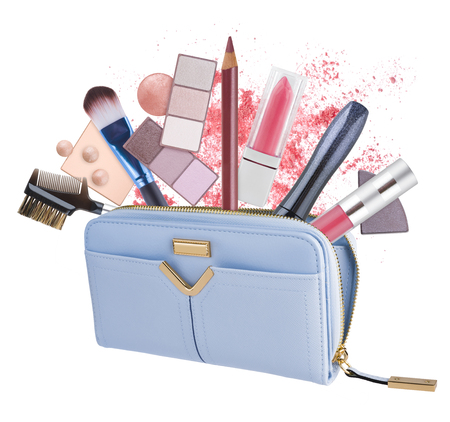 cosmetics bag: Cosmetics bag with flying out makeup products isolated on white