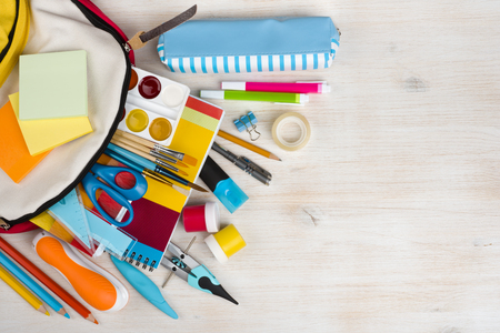 blue green background: Various stationery school and office supplies over wooden texture background