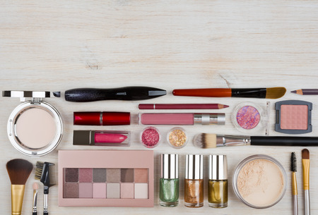 cosmetics products: Composition of makeup products and cosmetics on table with copyspace Stock Photo