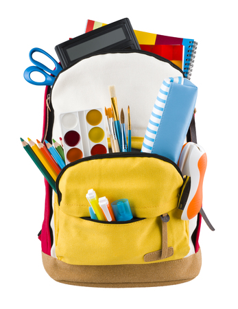 Backpack isolated on white backgorund with protruding school supplies Stock Photo