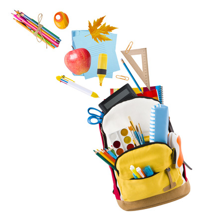 Backpack isolated on white backgorund with school supplies flying out Stock Photo