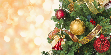 Decorated Christmas tree on abstract lights background with copy space Archivio Fotografico