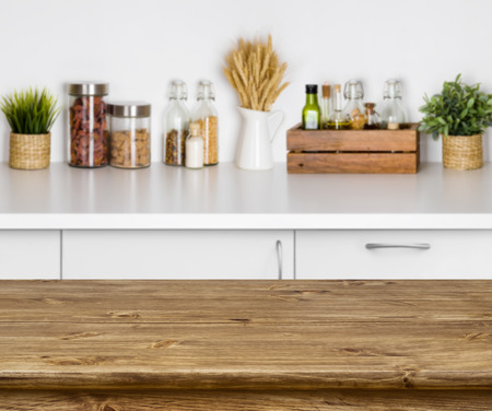 kitchen counter top: Wooden texture table with bokeh image of kitchen bench interior