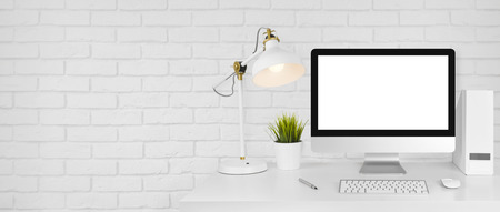 Design studio concept with workplace and white brick wall background Stok Fotoğraf