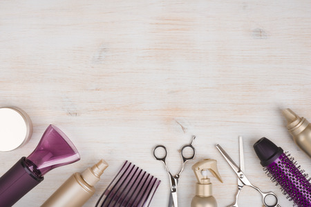 Hairdresser tools on wooden background with copy space at top Stock Photo