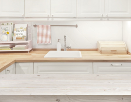 kitchen counter top: Blurred kitchen interior with wooden texture planks surface in front