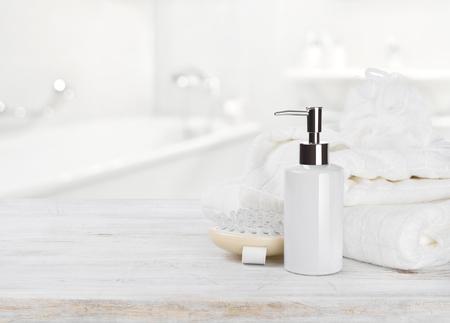 Soap dispencer, towels, massager and wisp of bast over blur Banco de Imagens - 78363425