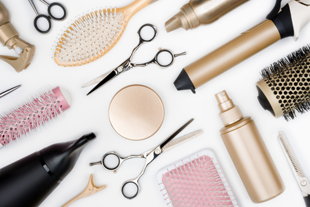 Hairdressing tools and various hairbrushes on white background top view Фото со стока - 87244794