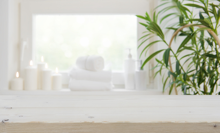 Wooden tabletop with copy space over blurred spa window background