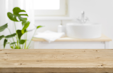 Empty tabletop for product display with blurred bathroom interior background