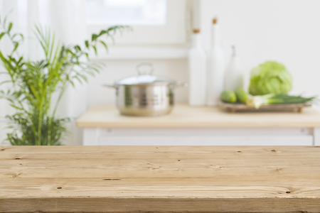 Table top with blurred kitchen interior as background Stockfoto