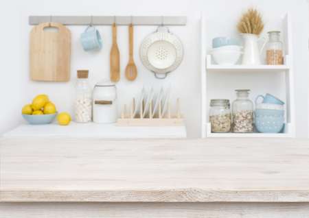 Wooden table top on blurry decorated kitchen interior furniture background Stock Photo