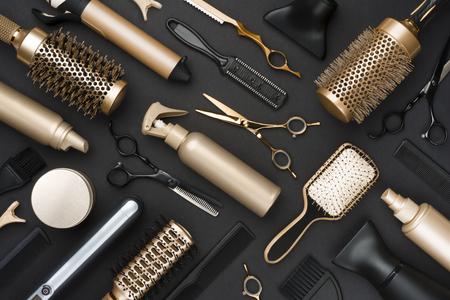 Full frame of professional hair dresser tools on black background Фото со стока