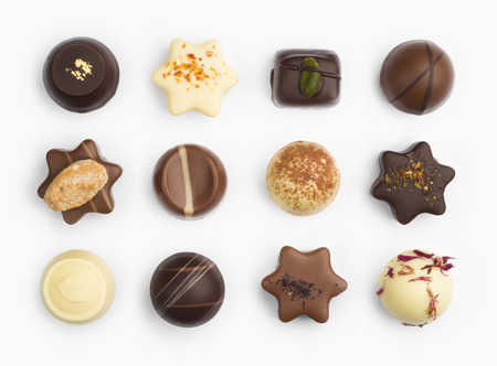 Top view of various chocolate pralines isolated on white Banco de Imagens