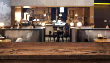 Table top counter with blurred people and restaurant interior Banco de Imagens