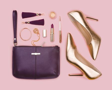 Women set of gold purple fashion accessories on pink