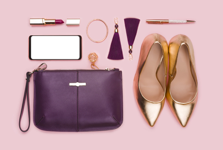 Business women set of fashion accessories isolated on pink