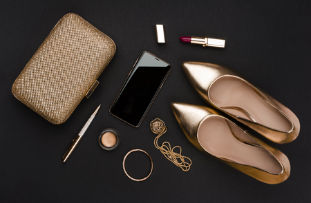Composition of business woman set of fashion accessories on black