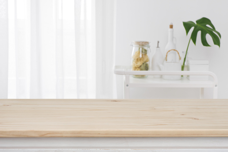 Blurred kitchen window, shelves with wooden tabletop in front Banco de Imagens