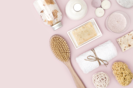Natural spa skincare products on pink  with copy space