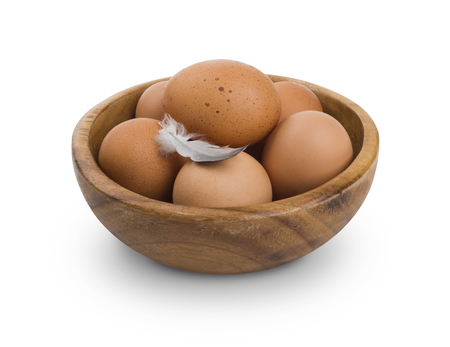 Several brown Eggs in wooden bowl isolated on white Banco de Imagens