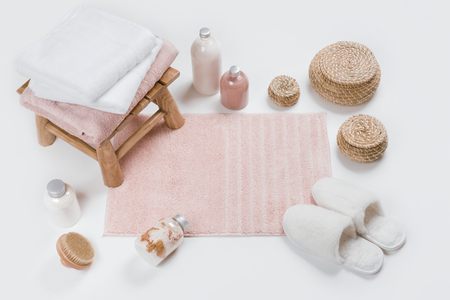 Spa skincare accessories with wooden stool, soft carpet and slippers