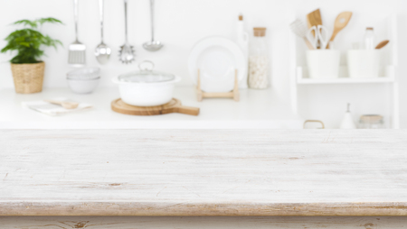 Rustic wooden table top on blurred kitchen shelf Banco de Imagens