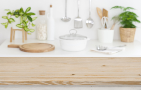 Wooden table top on blurred kitchen counter Banco de Imagens